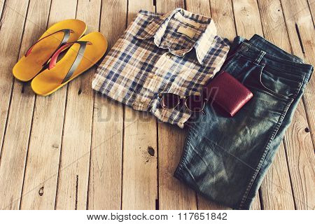 Vintage,plaid Shirt,jean,slippers,wallet And Sunglasses On Wood Background