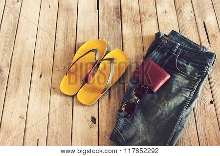 Vintage,jean,slippers,wallet And Sunglasses On Wood Background