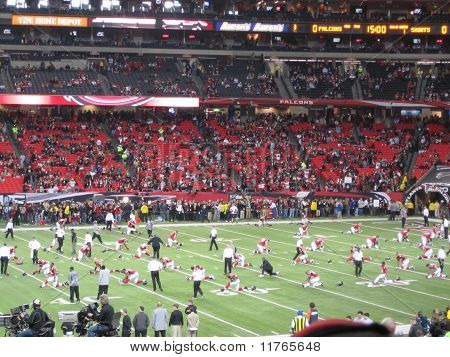 Players Stretching on Field