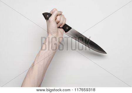 Murder And Halloween Theme: A Man's Hand Reaching For A Knife, A Human Hand Holding A Knife Isolated