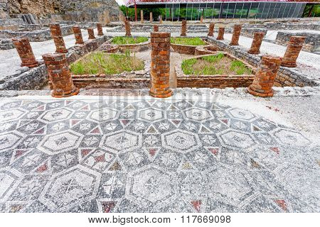 View of the inner pond and garden with the Peristyle columns and mosaic floor, on the Swastika Domus. Conimbriga in Portugal, is one of the best preserved Roman cities on the west of the empire.