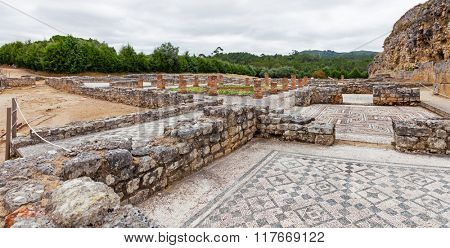 Roman ruins of Conimbriga. Overal view of the Swastika Domus, with the rooms, the peristyle and garden. Conimbriga, in Portugal, is one of the best preserved Roman cities on the west of the empire.