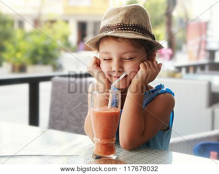 Fun Kid Girl In Hat Screwing Up Her Eyes And Waiting The Moment To Drink The Smoothie Tasty Juice