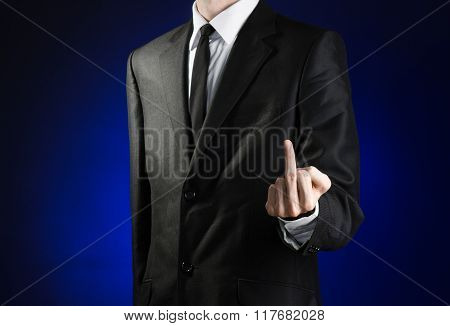 Businessman And Gesture Topic: A Man In A Black Suit And White Shirt Showing Middle Finger Gesture O