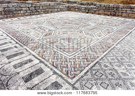 Complex and elaborate Roman tessera mosaic pavement in the House of the Skelletons. Conimbriga in Portugal, is one of the best preserved Roman cities on the west of the empire.