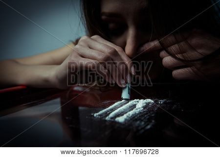 Young girl inhales cocaine close up photo poster