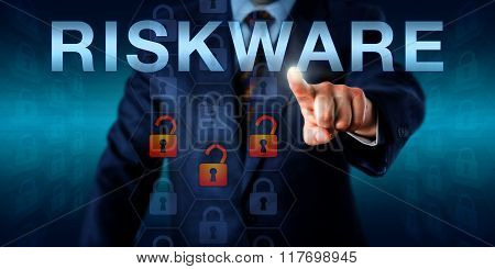 IT specialist is touching RISKWARE on an interactive screen. Three opened virtual padlocks among otherwise intact lock icons embedded in a hexagonal coding matrix signify a possible software risk. poster