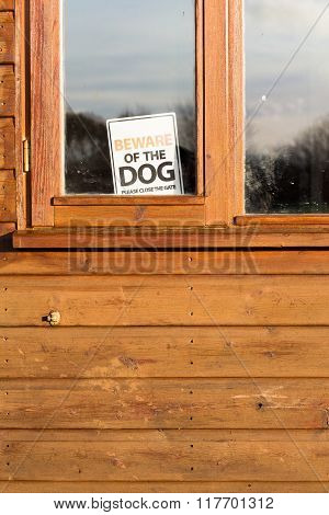 Beware Of Dog Sign In Window