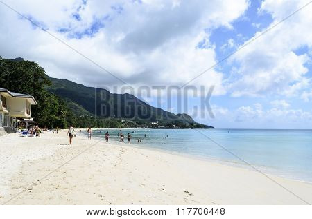 MAHE, SEYCHELLE - JULY 09: Tourists enjoy the sunny weather and relaxing on the beautiful beach on 9 July 2015 in Baie Beau Vallon, Mahe Island, Seychelle.