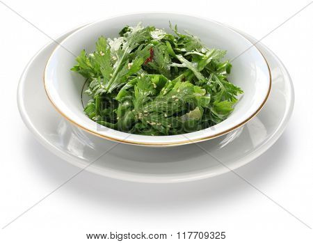 crown daisy salad with sesame isolated on white background