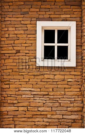 A new window on the old red brick wall.