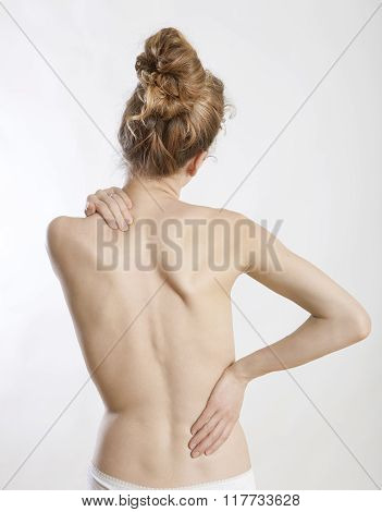 a young naked woman holding her hands on the back white background