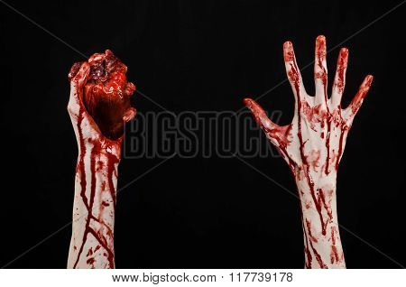 Blood And Halloween Theme: Terrible Bloody Hand Hold Torn Bleeding Human Heart Isolated On Black