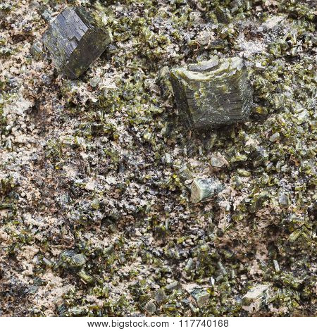 Green Epidote Crystals On Rock Close Up