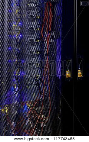 rear wall of a supercomputer with wires and lights