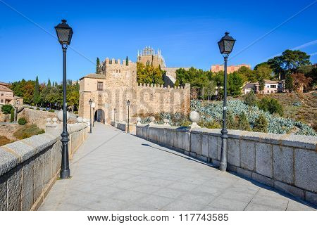 Toledo Spain. Puente de San Martin is a medieval bridge across the river Tajo in Toledo Spain. The bridge was constructed in the late 14th century.