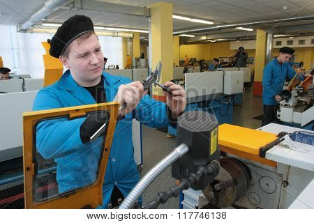 College Student In A Training Machine Shop