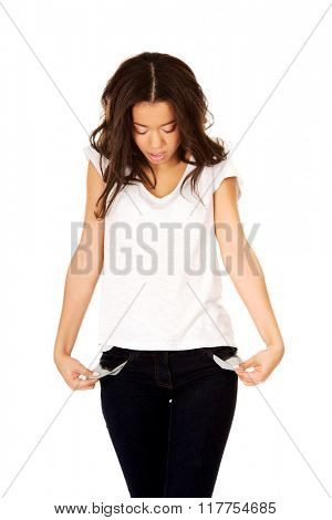 Woman showing empty pockets.