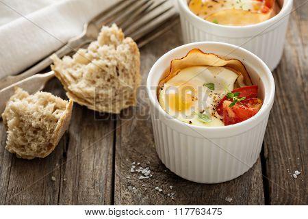Baked eggs in small ramekin