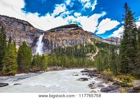 Autumn day in Yoho National Park in the Rocky Mountains of Canada. The tremendous falls Takakkaw formed by thawing of glacier Daly