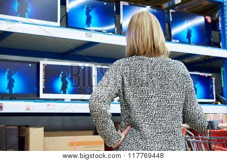Woman Looks At Lcd Tvs In Shop