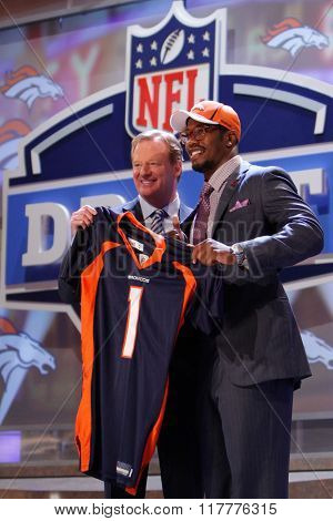 Von Miller (R) is introduced by Commissioner of the National Football League Roger Goodell as the second pick to the Denver Broncos at the NFL Draft 2011 at Radio City Music Hall in New York, NY.