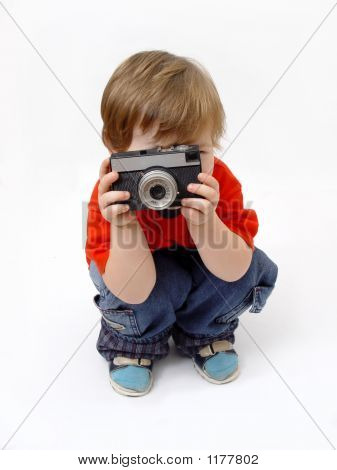 Sitting Boy And Photo Camera