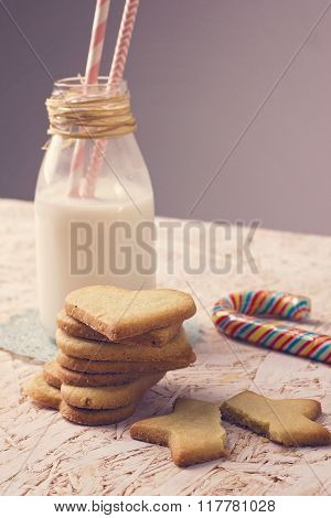 Sugar cookies with milk bottle and lollipop