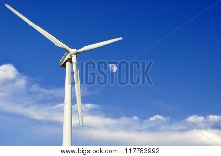 Green Meadow With Wind Turbine Electricity.