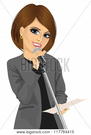 woman speaking into a microphone