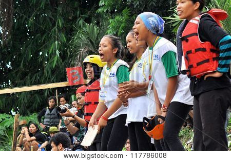 Young people in Medan, Indonesia, give support for they team who is fight in the Deli rafting competition, 11/02/2016. This competition be held in the Deli rivers in Medan.