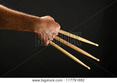 Wolverine Hand With Three Drumsticks Over Black