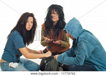 Sad Beggars Searching In Garbage