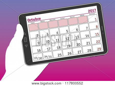 Tablet Pc With A Calendar Sheet Of October 2017 In Spanish