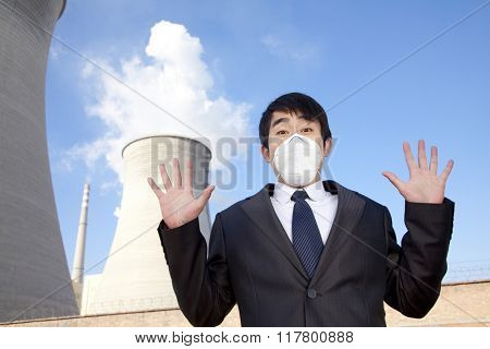 Businessman at power plant with face mask