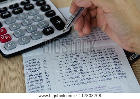 Calculator And Pen On Bank Account Passbook, Selective Focus