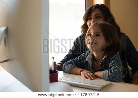 Mom And Daughter At The Computer