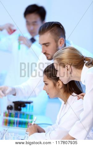 Young medical technicians working in laboratory