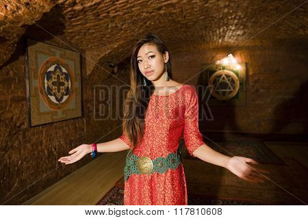beauty asian girl greeting in holl of spa salon, hands gesturing welcome