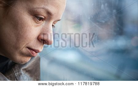 A woman in streetcar alone and depressed