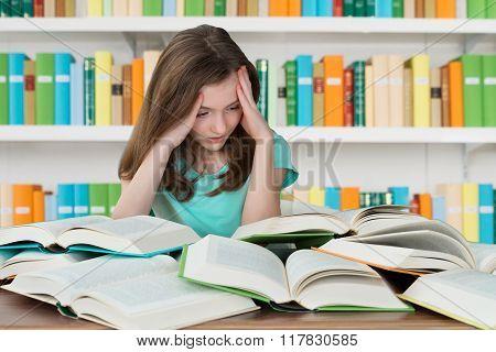 Overburdened Schoolgirl Studying In Library