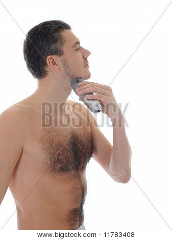 Young Handsome Man Shaving In The Morning . Isolated On White Background