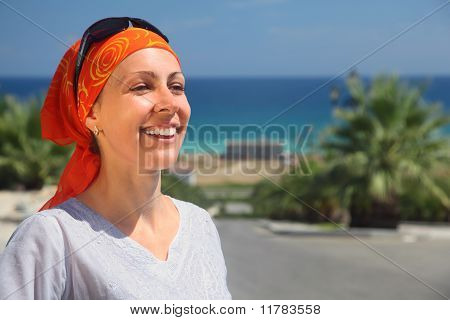 Portrait Of Smiling Girl In Red Kerchief And Sunglasses Against The Sea