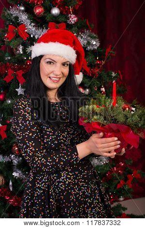 Woman Holding Christmas Arrangement