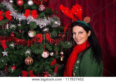 Happy Woman With Xmas Tree