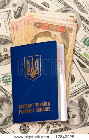 International Ukrainian passport with Hryvna banknotes on US dollars background