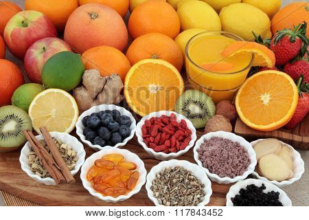 Large super food fruit selection with herbs, spices and supplement capsules for cold and flu remedy including foods high in antioxidants and vitamin c.