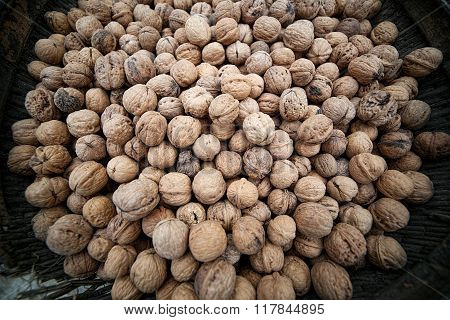 Basket of walnuts on a market square. A lot of nuts.
