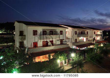 Building Of Sanatorium At Night. Three-storey Villas With Private Balconies