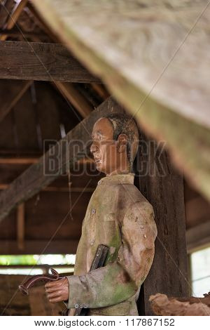 Old Wooden Statue Of Tau Tau. Suaya Is Cliffs Old Burial Site In Tana Toraja. South Sulawesi, Indone